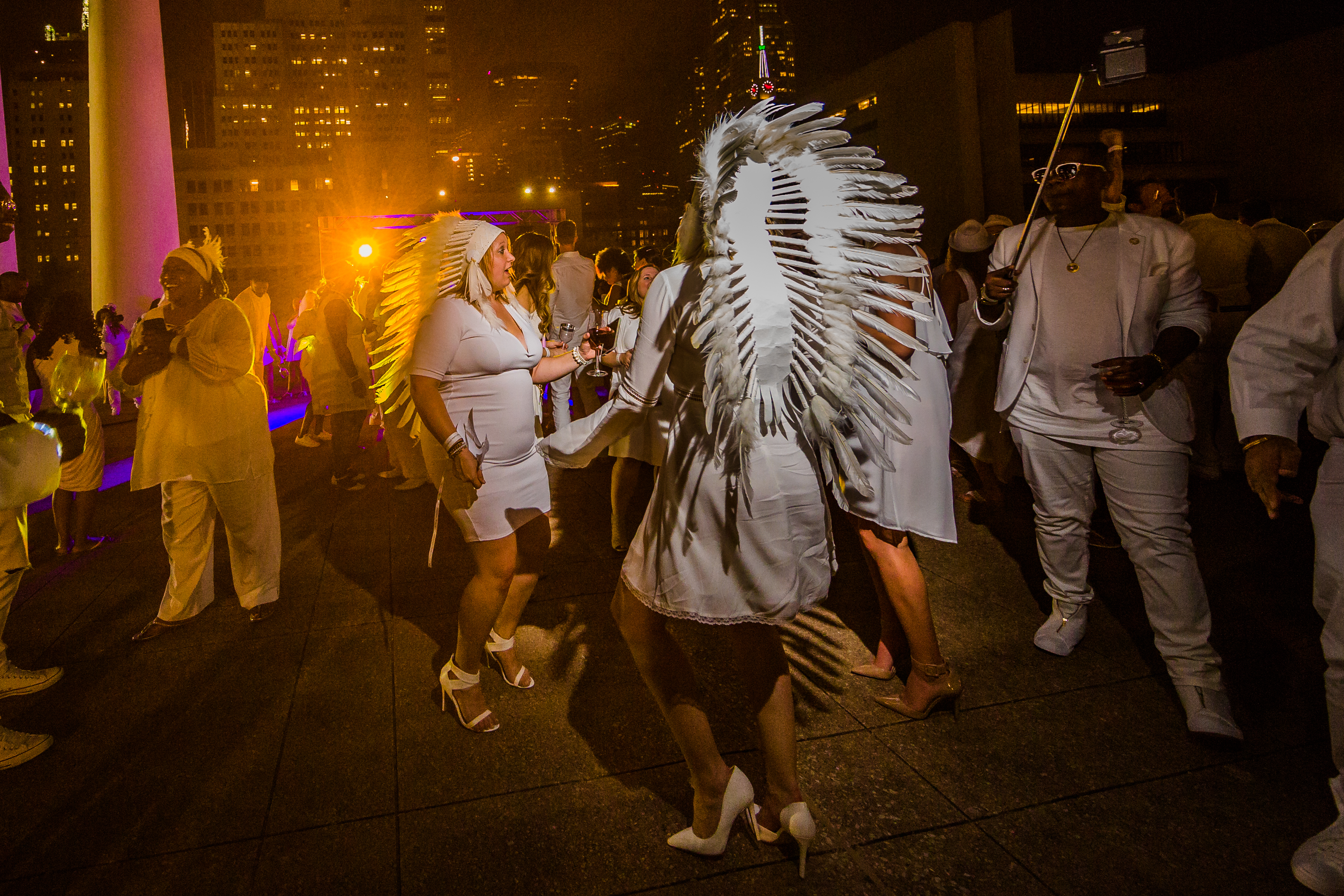 Beautiful ladies in headdresses | Diner En Blanc 2016 | Photo by Justin Yoder